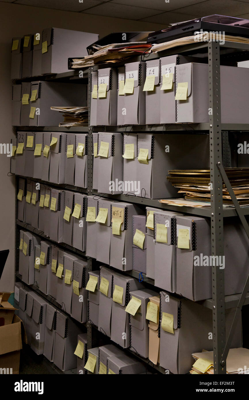 File storage containers stacked in office file room - USA - Stock Image