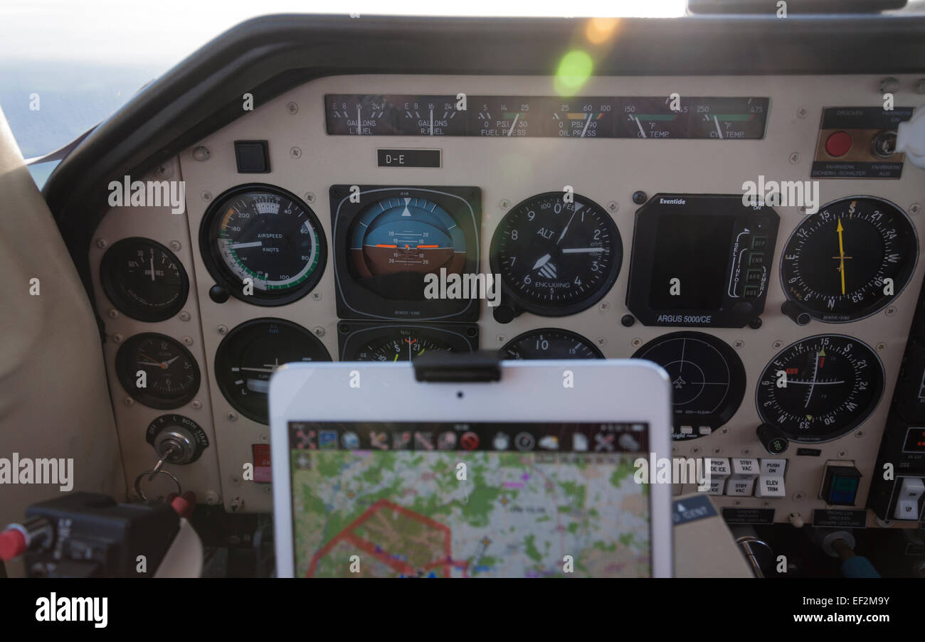 Close up cockpit view with ipad mini as moving map display in flight  Mooney 201 M20J in 6250 ft. above sea level - Stock Image