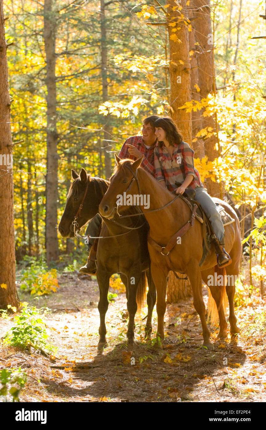 Couple Horseback Riding In The Forest Stock Photo Alamy
