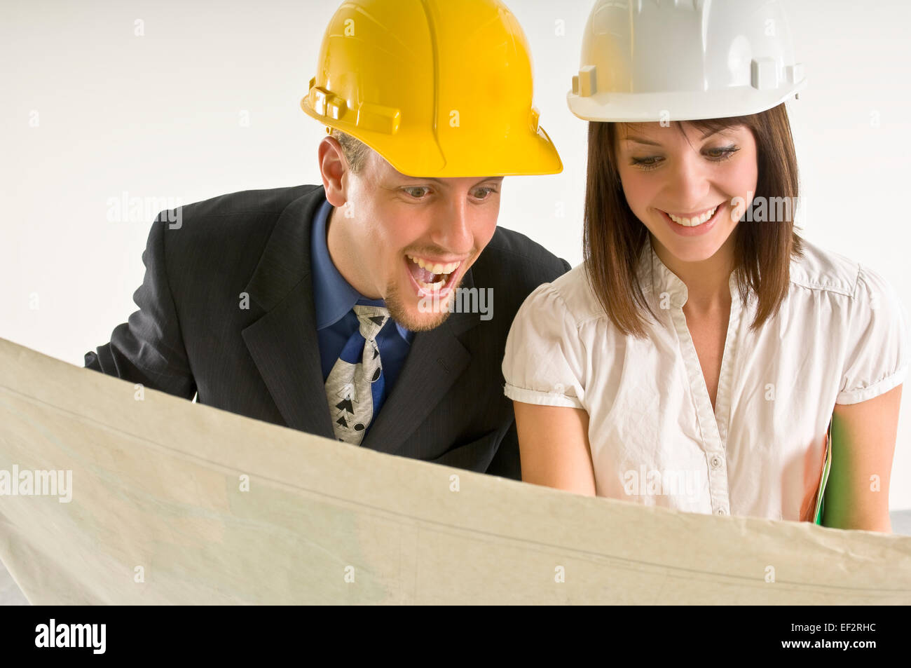 Two architects looking at blueprints - Stock Image