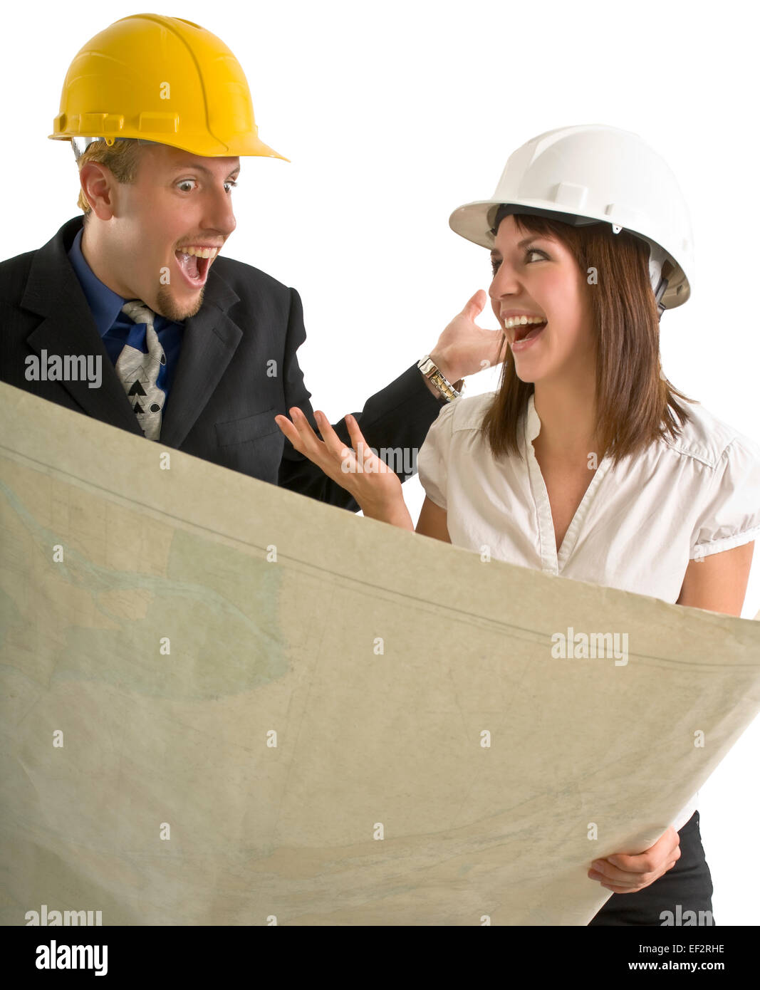 Two excited architects looking at blueprints - Stock Image