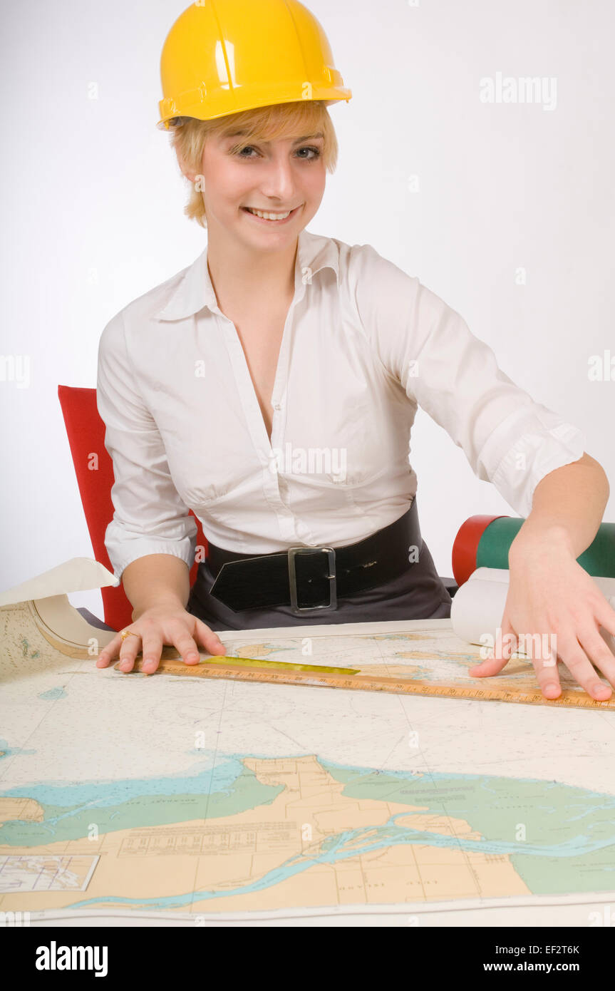 Woman making measurements on a map - Stock Image