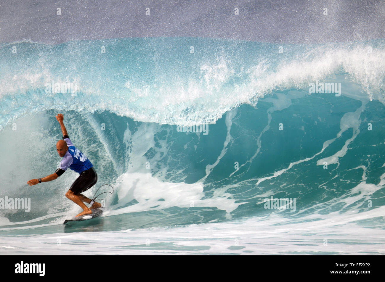 Pro-surfer, Kelly Slater, catches a tube at the 2014 Pipemasters, Banzai Pipeline, Ehukai Beach Park, North Shore, - Stock Image
