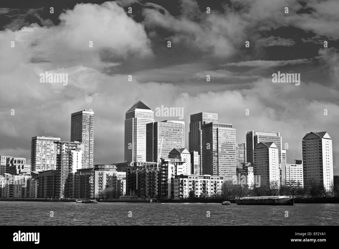 Black and white view of Canary Wharf seen from the River Thames, London, England UK - Stock Image