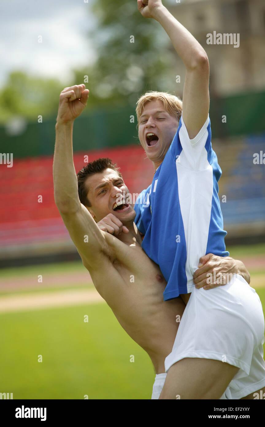 Sportstadion Fussballspieler Gestik Aussen Stadion Fu?ball Fussballspiel Spiel Sport Mann Sportler Freude Jubel - Stock Image
