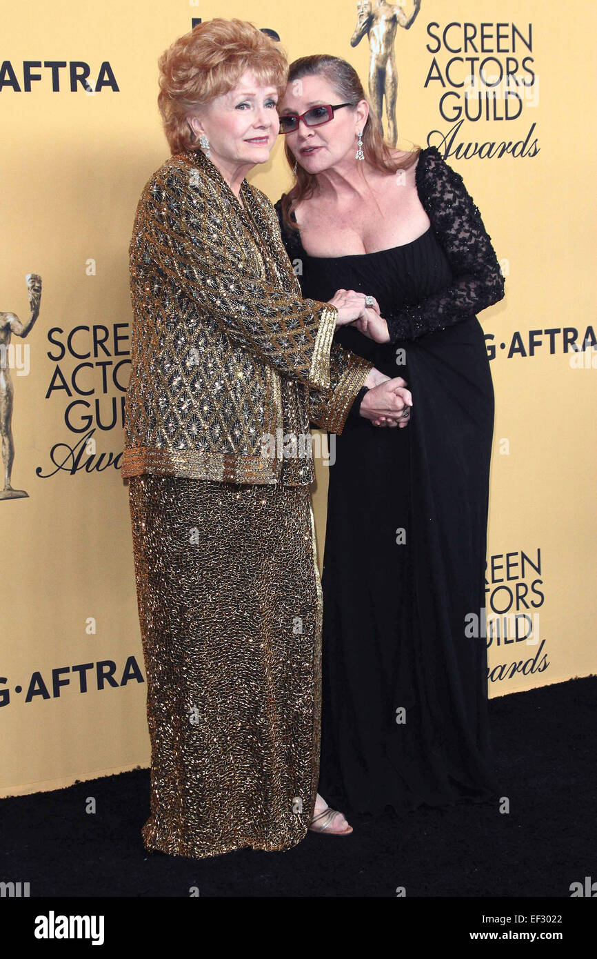 Los Angeles, California, USA. 25th Jan, 2015. Carrie Fisher, Debbie Reynolds pose in the press room during The 21st - Stock Image
