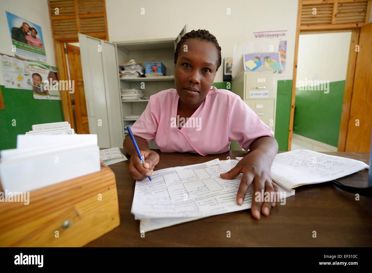 Nurse managing patient files, health care centre in Brésilienne, Bainet, Sud-Est Department, Haiti - Stock Image
