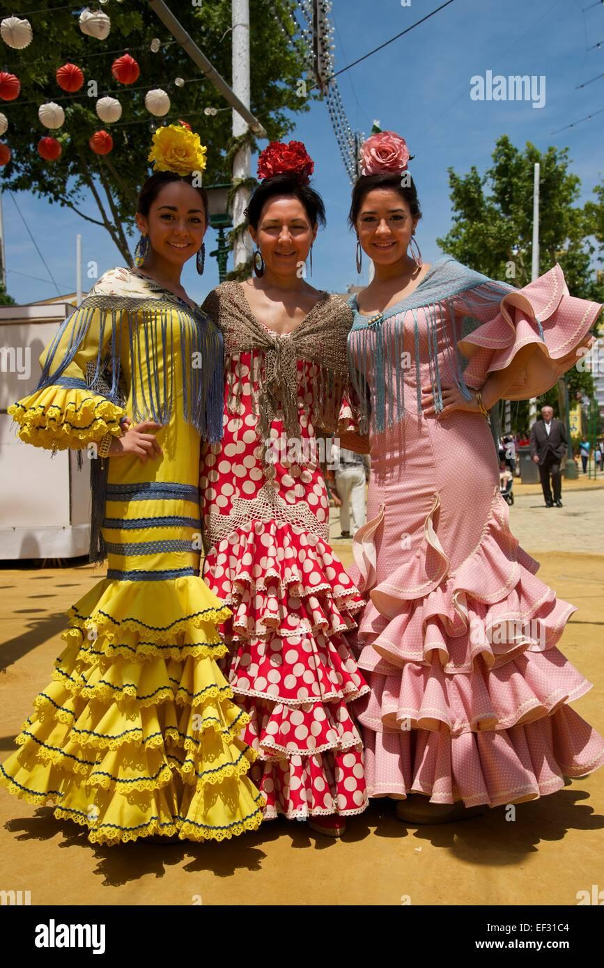 Flamenco dancers at the Feria de Abril, Seville, Andalucía, Spain - Stock Image