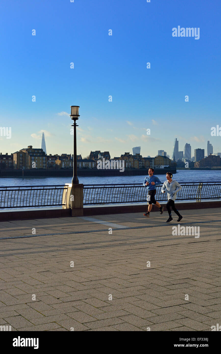 Runners, Canary Riverside, Docklands, London E14, United Kingdom - Stock Image