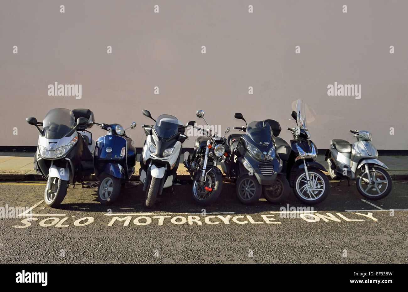 free motorcycle parking knightsbridge  Motorcycle Parking Uk Stock Photos