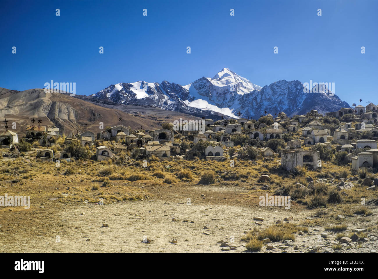 Graveyard with Huayna Potosi mountain in the background, peak in Bolivian Andes - Stock Image