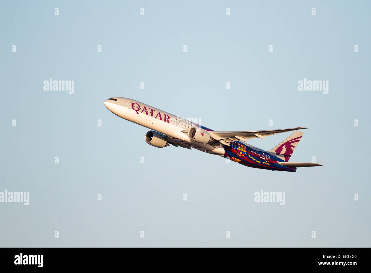 A7-BAE Qatar Airways Boeing 777-3DZ/ER,FC Barcelona livery, Surrey, England, UK - Stock Image