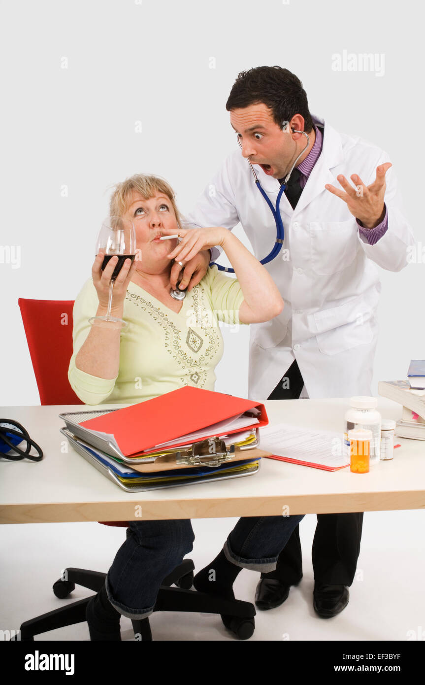 Shocked doctor listening to unhealthy woman's heartbeat - Stock Image