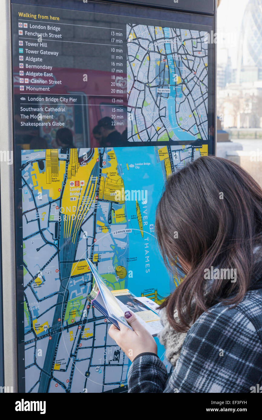 England, London, Visitor Looking at Street Map of London Bridge Station and Surrounding Area - Stock Image