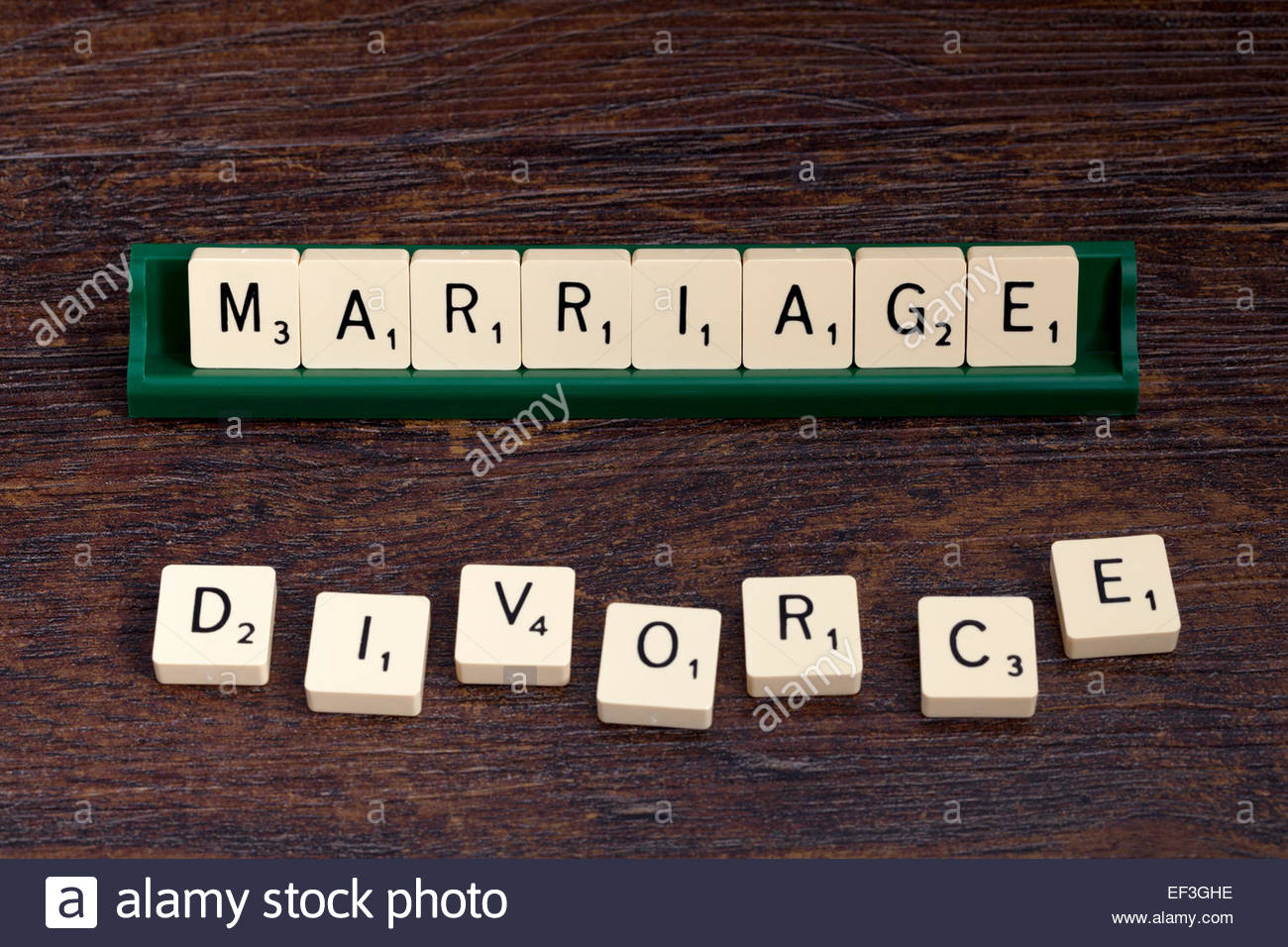 Marriage and Divorce spelled out with scrabble letters. - Stock Image