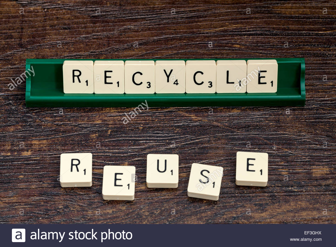 Recycle and Reuse spelled out with scrabble letters. - Stock Image