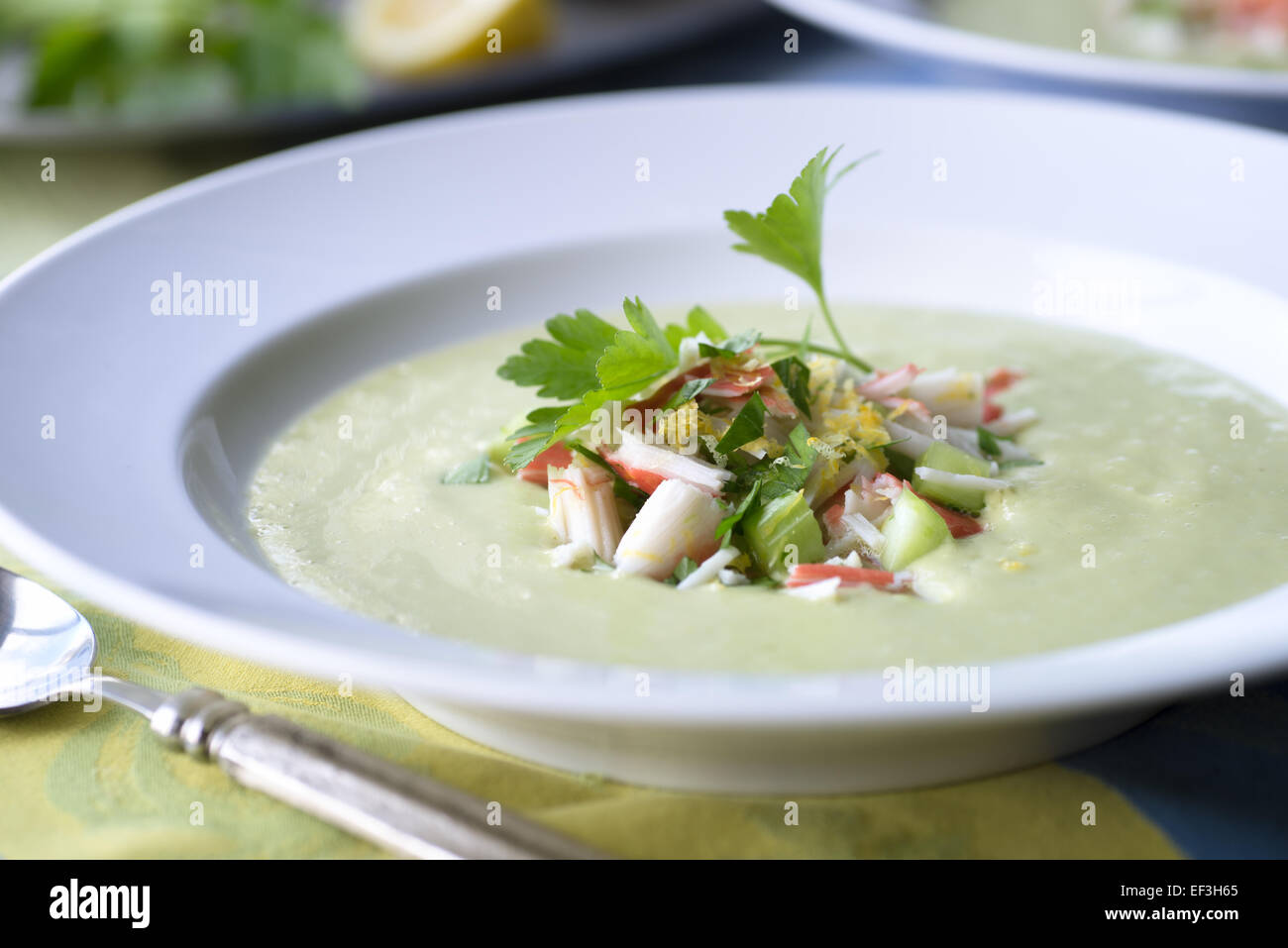 Creamy avocado soup with fresh crab salad - Stock Image