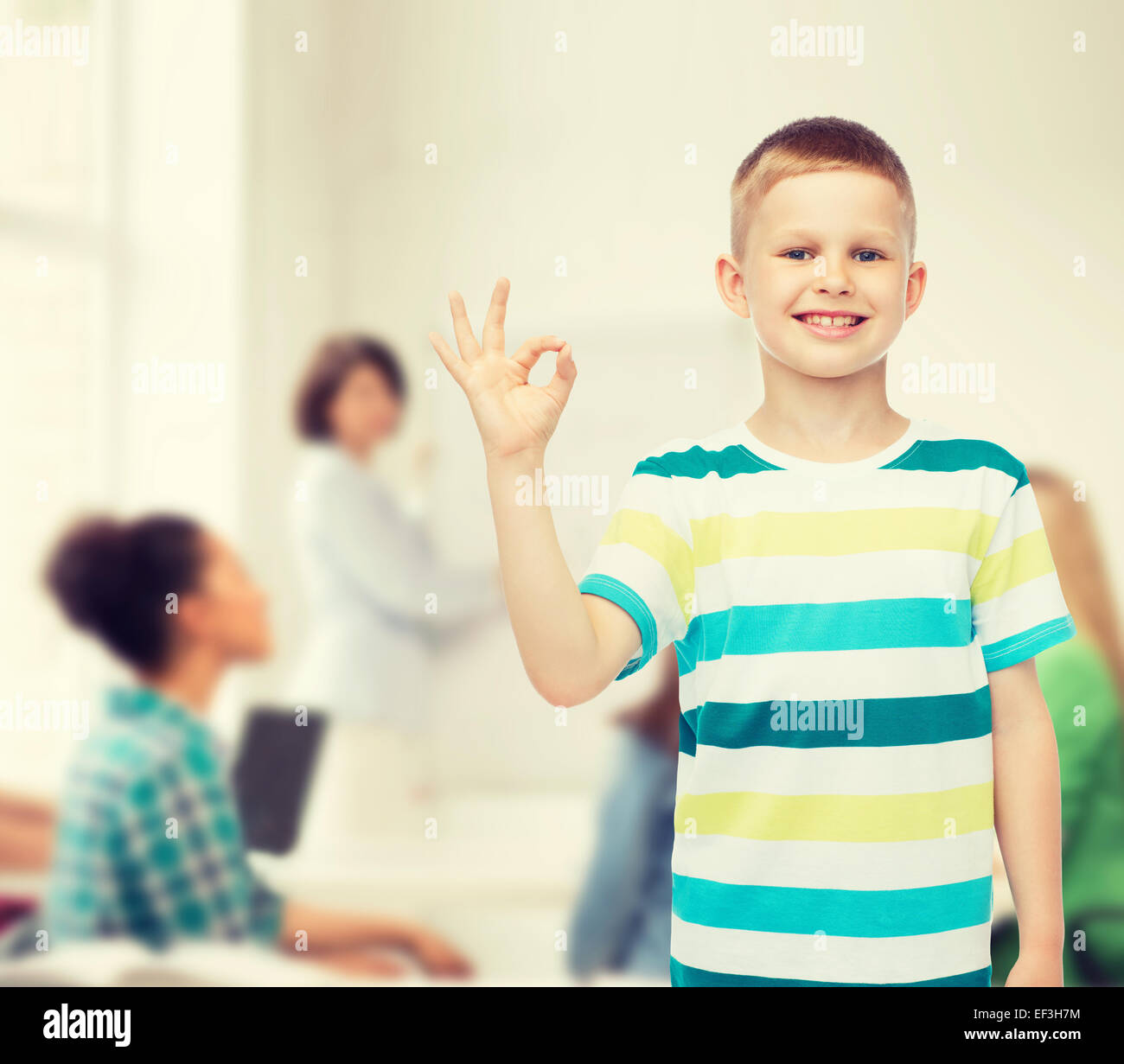 eb34c74d6a little boy in casual clothes making ok gesture Stock Photo: 78140712 ...