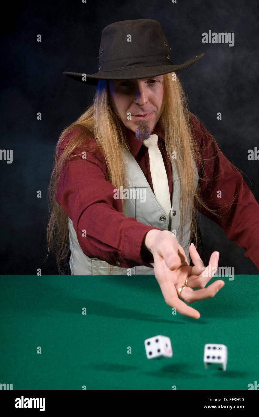 Man rolling dice Stock Photo: 78140748 - Alamy
