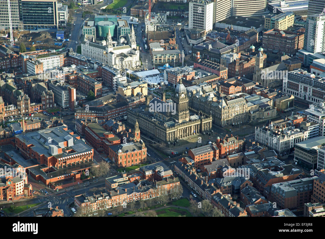 a wintery view of Leeds city centre with the Town Hall and Civic Hall prominent - Stock Image
