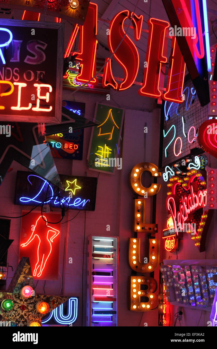 Displays of neon at the late Chris Bracey's Walthamstow showroom God's Own Junkyard - Stock Image