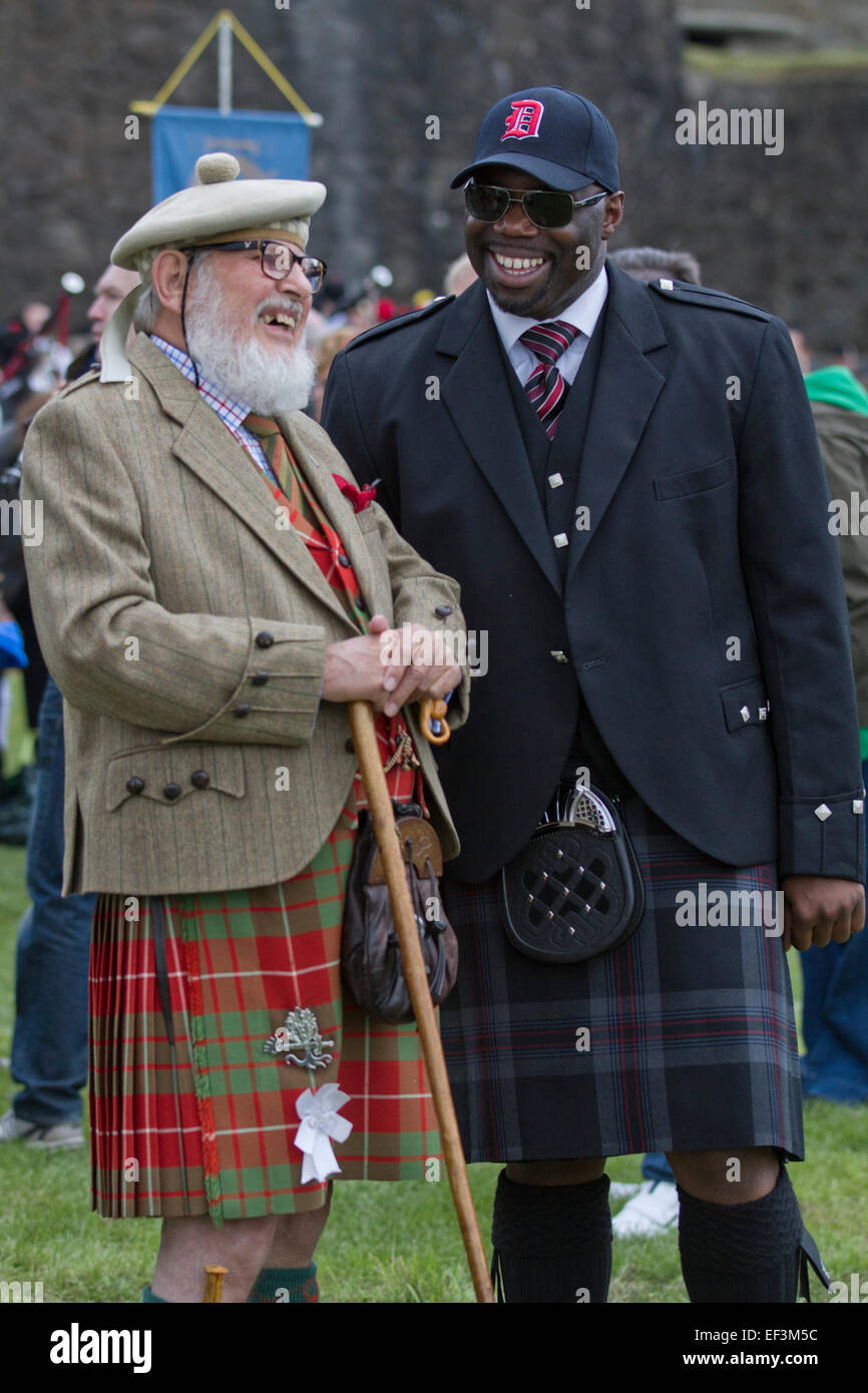 Two men in traditional Scottish kilts laughing before the start of Pipefest Stirling. Stock Photo