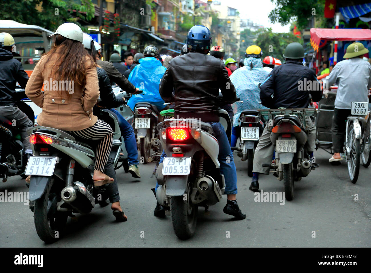 Scooters as seen from bicycle rickshaw ride, Old Quarter (aka The 36 Streets), Hanoi, Vietnam - Stock Image