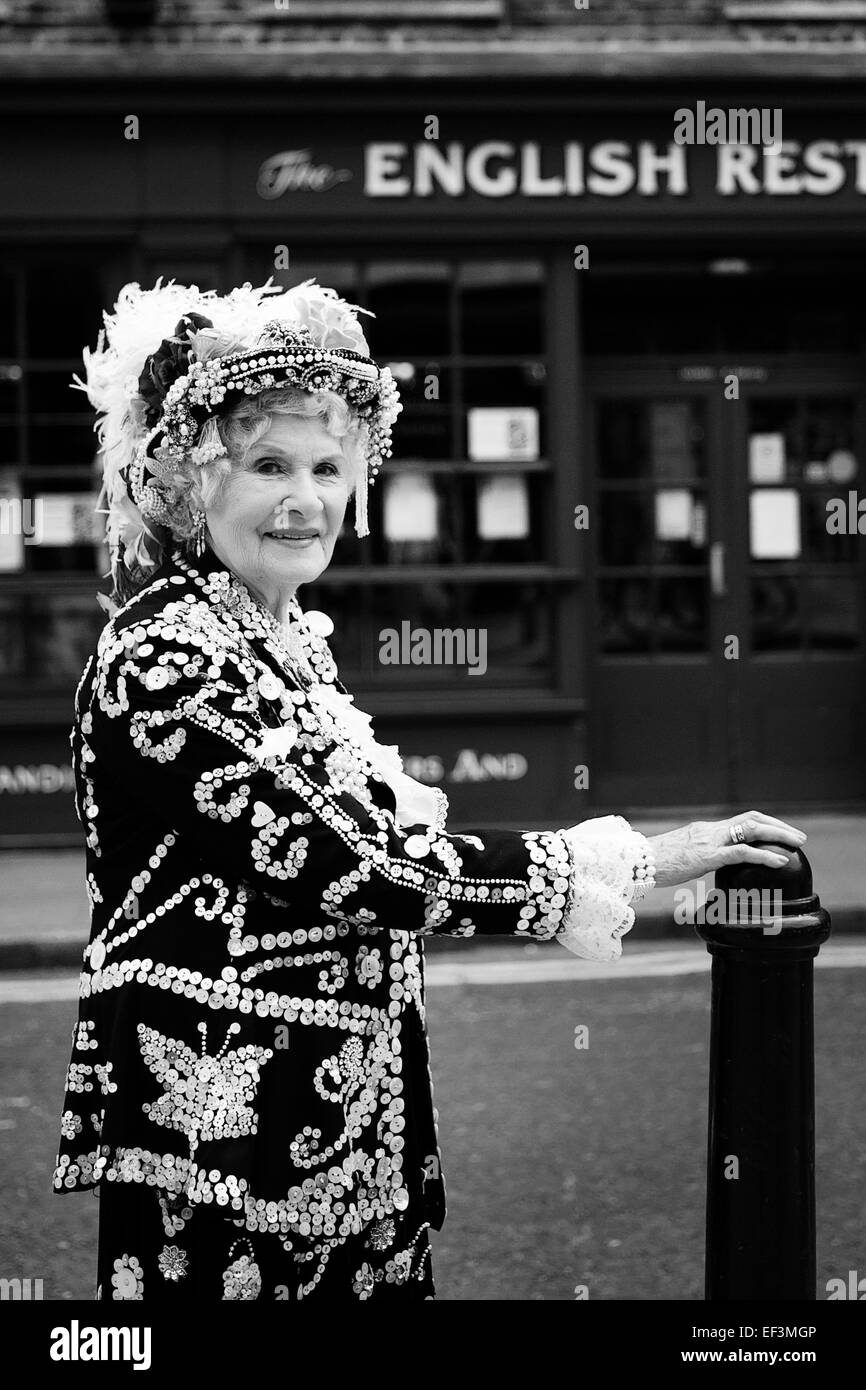 Pearly Queen, wearing traditional ceremonial clothes covered with pearl buttons, working class culture, London UK - Stock Image