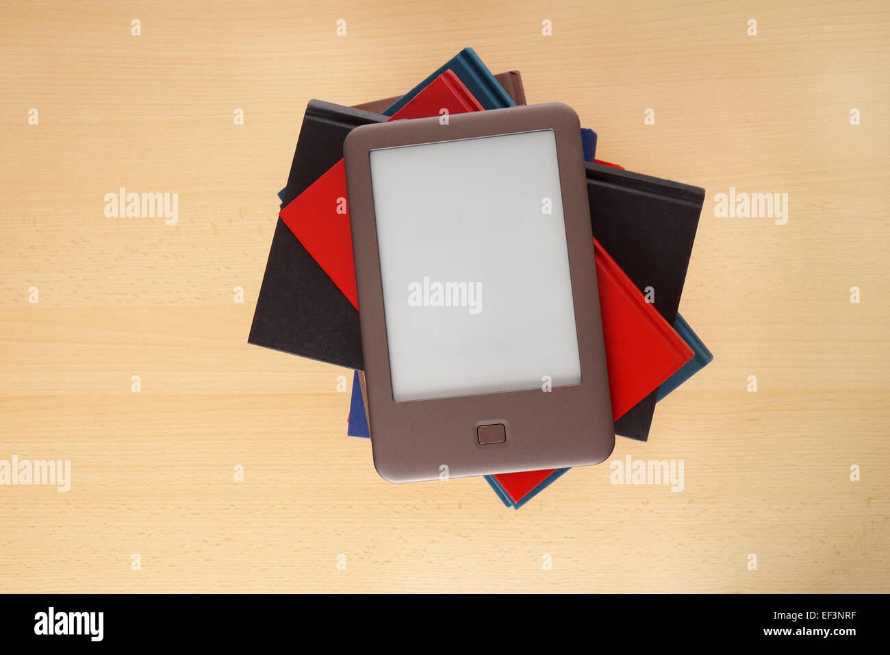 ebook reader on pile of books - Stock Image