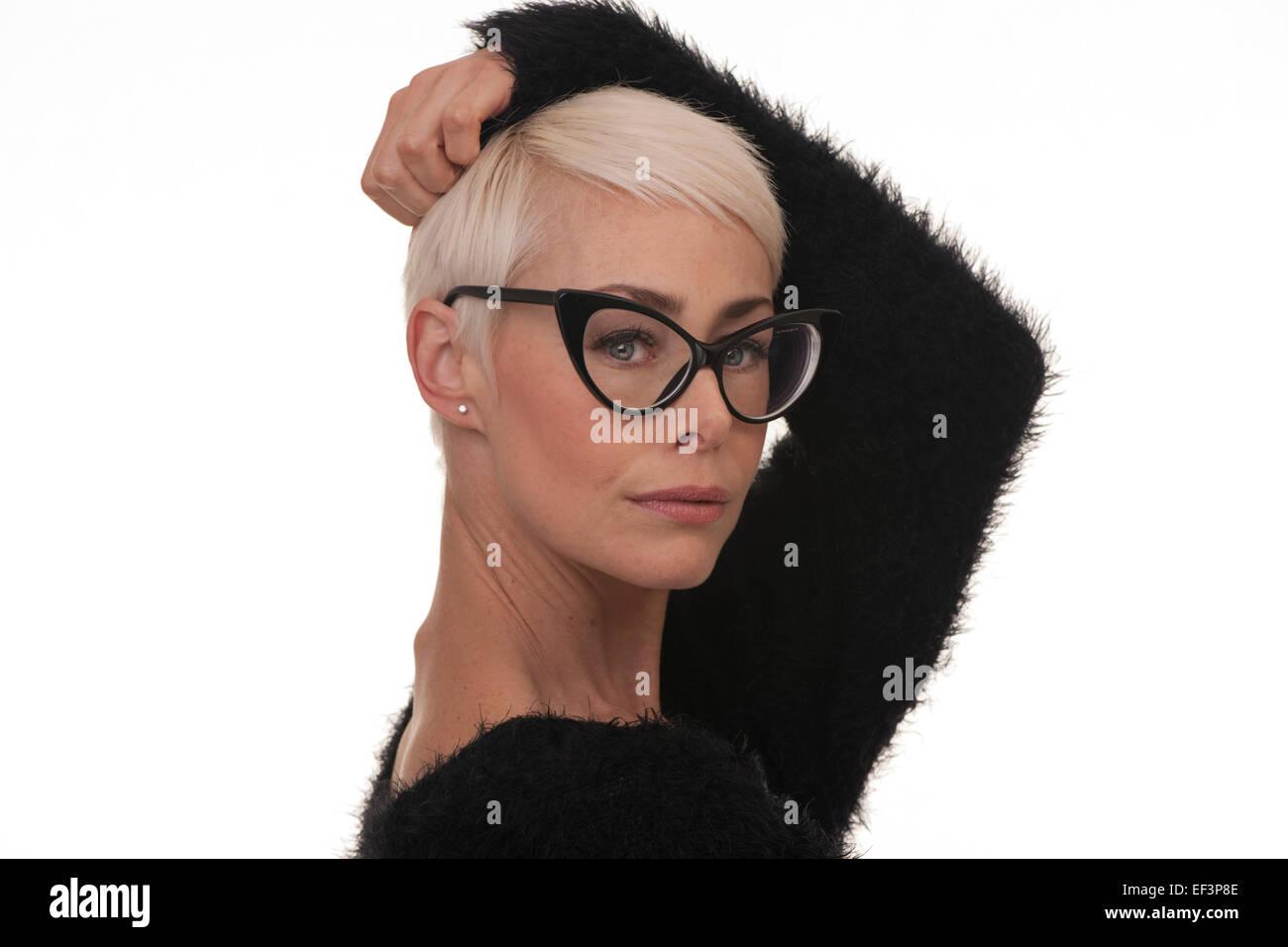 mature woman wearing big black framed glasses stock photo: 78144654