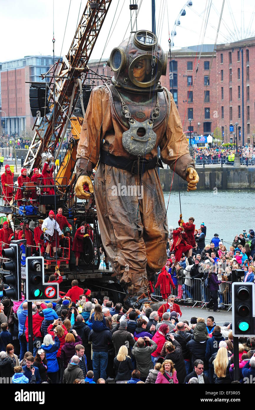 Royale De-Luxe giant diver uncle walking along The Strand in Liverpool as part of the 100th anniversary of the Titanic - Stock Image