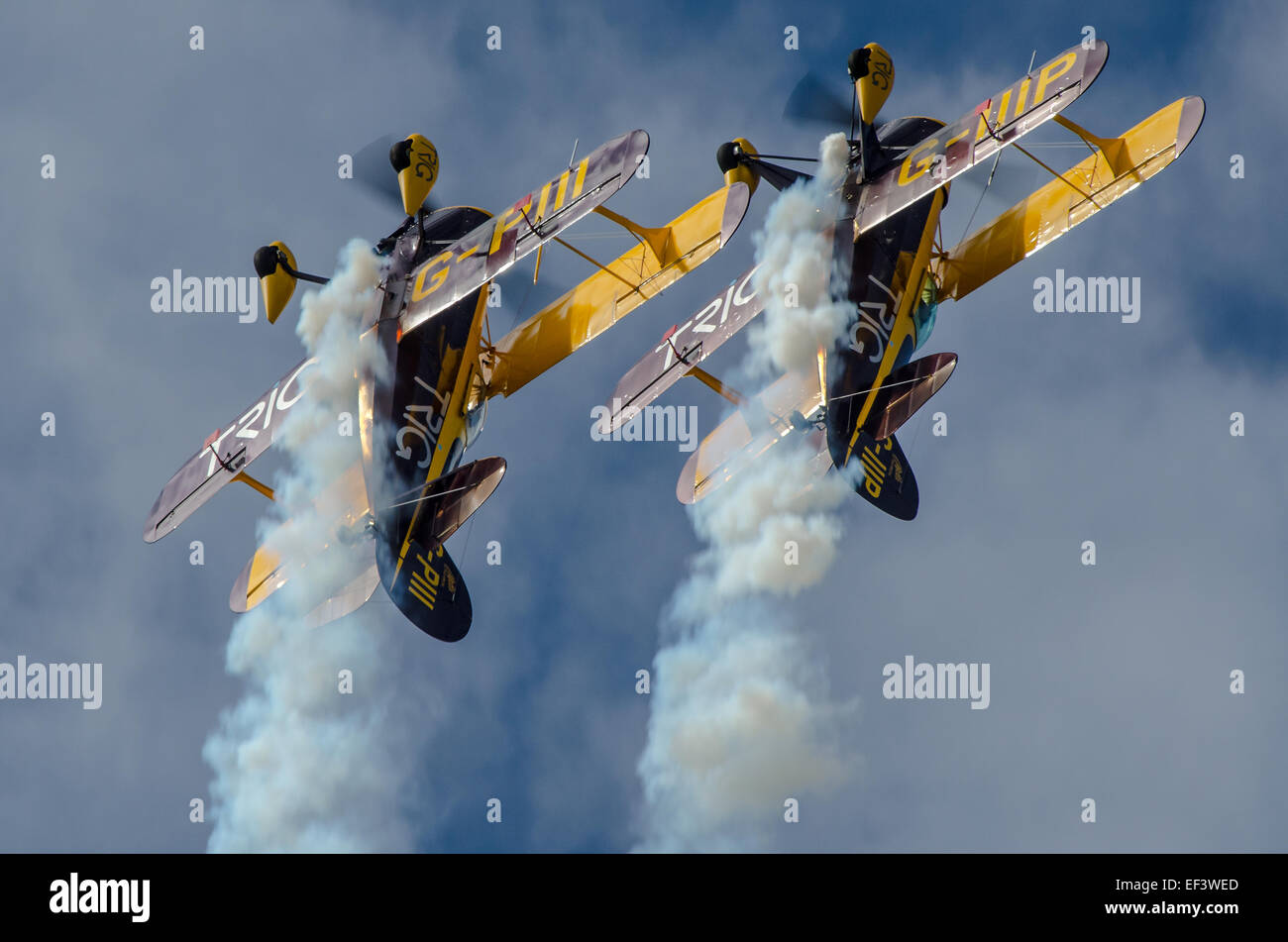 The Trig Aerobatic Team fly at airshows around Europe in classic Pitts biplanes. Pilots are Richard Grace and Dave - Stock Image