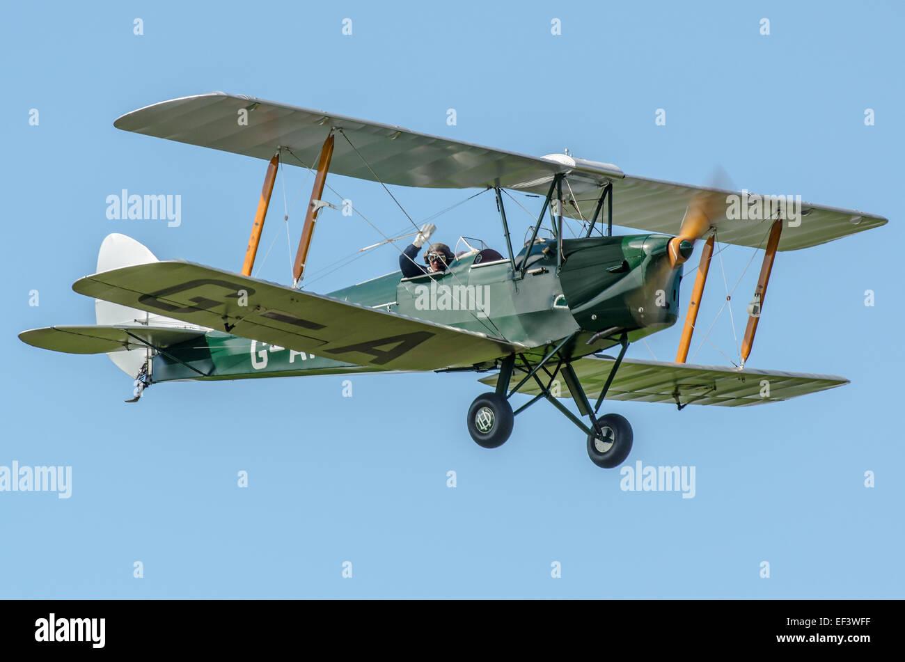 Jeff Milsom, former RAF pilot, in Tiger Moth G-AHOO. Jeff is leader of the Tiger 9 display team - Stock Image
