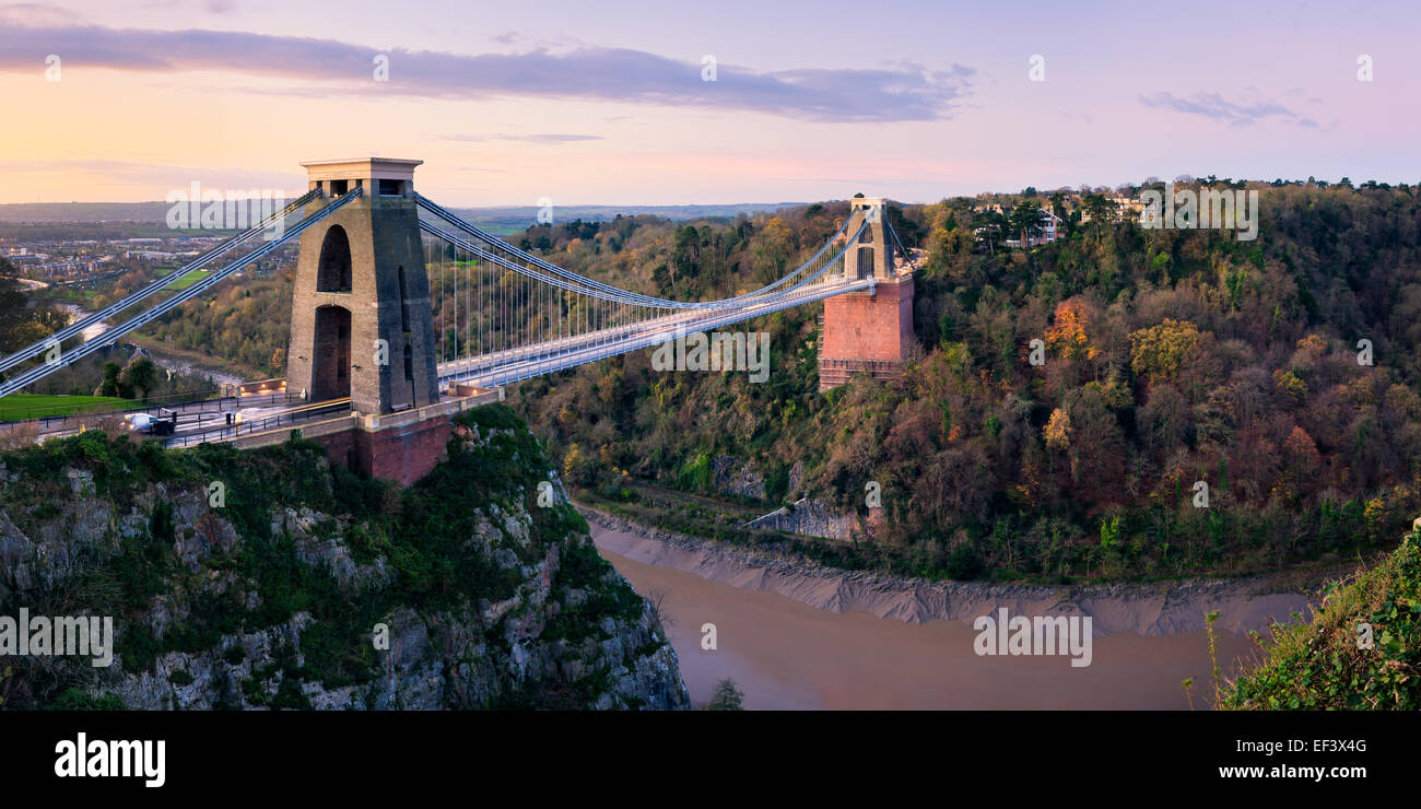 Clifton suspension bridge in warm light with autumn colours in Leigh Woods on the other side. Stock Photo