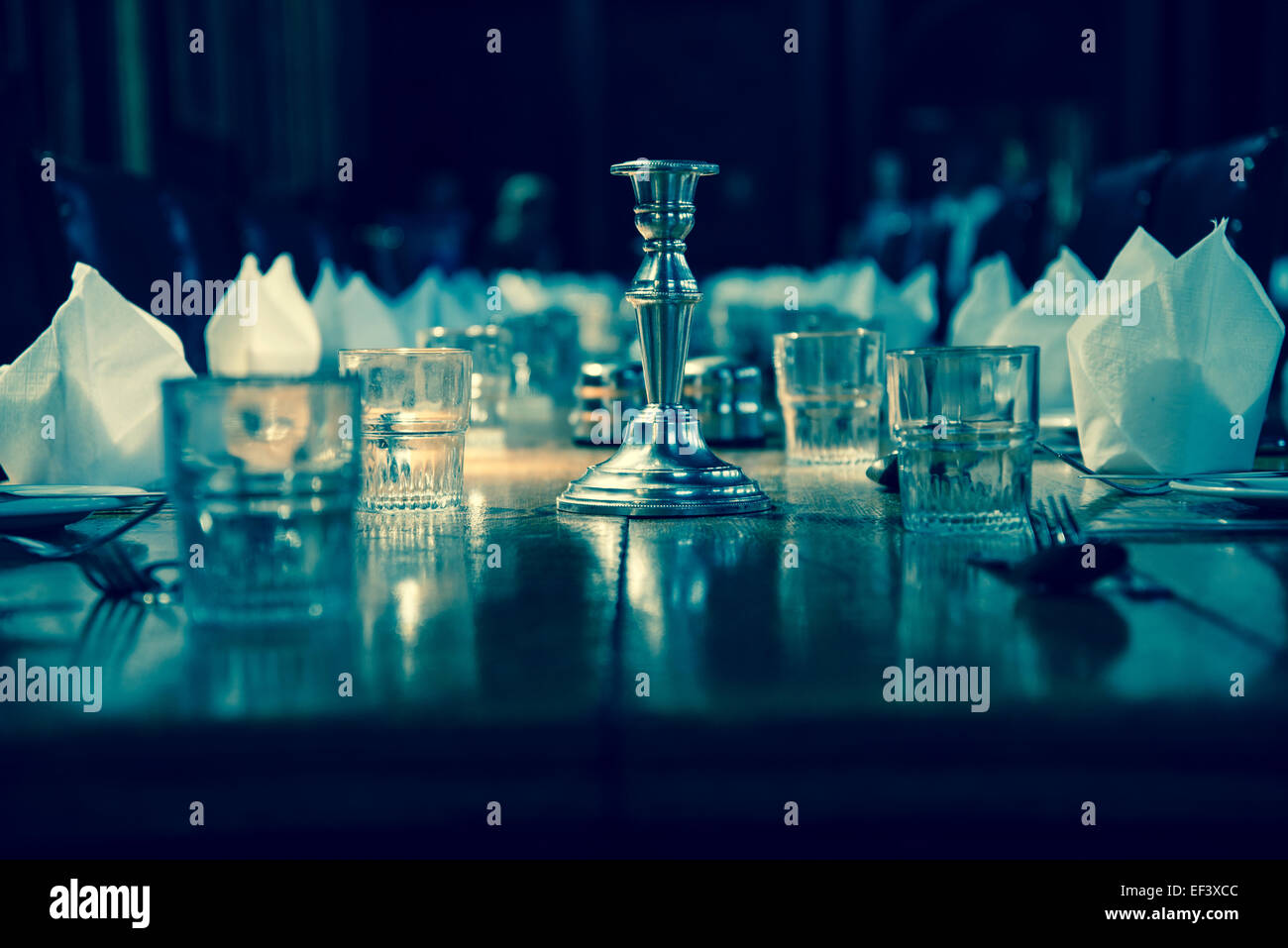 Set out table with glasses and candlestick - Stock Image