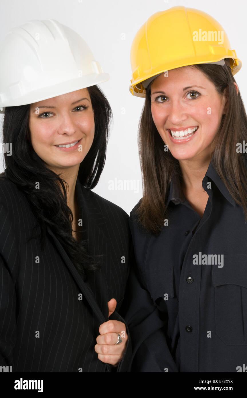 Two women wearing hard hats - Stock Image