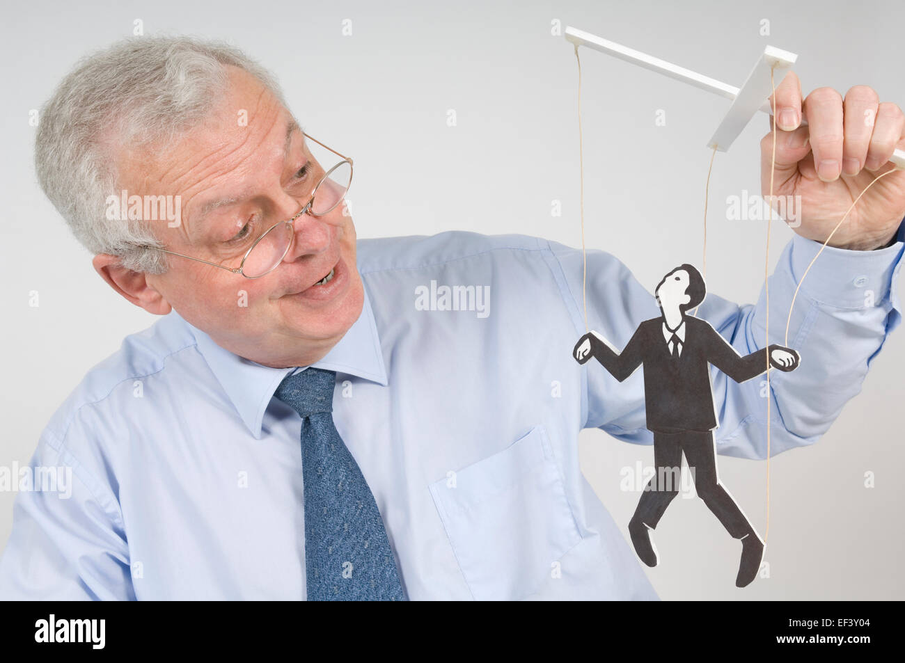 Man playing with a puppet Stock Photo