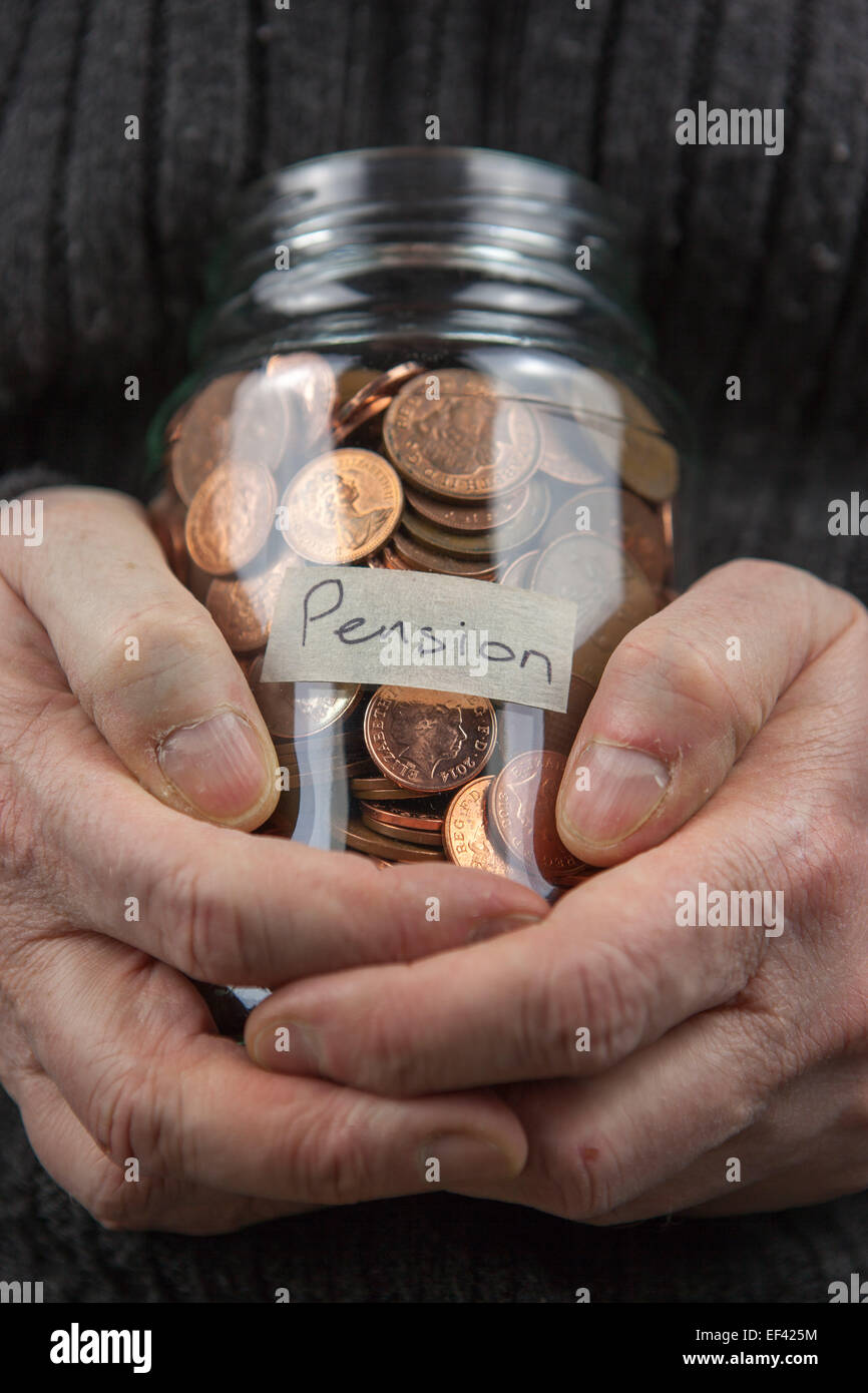 A old man clutching a pension pot in a glass jar. - Stock Image