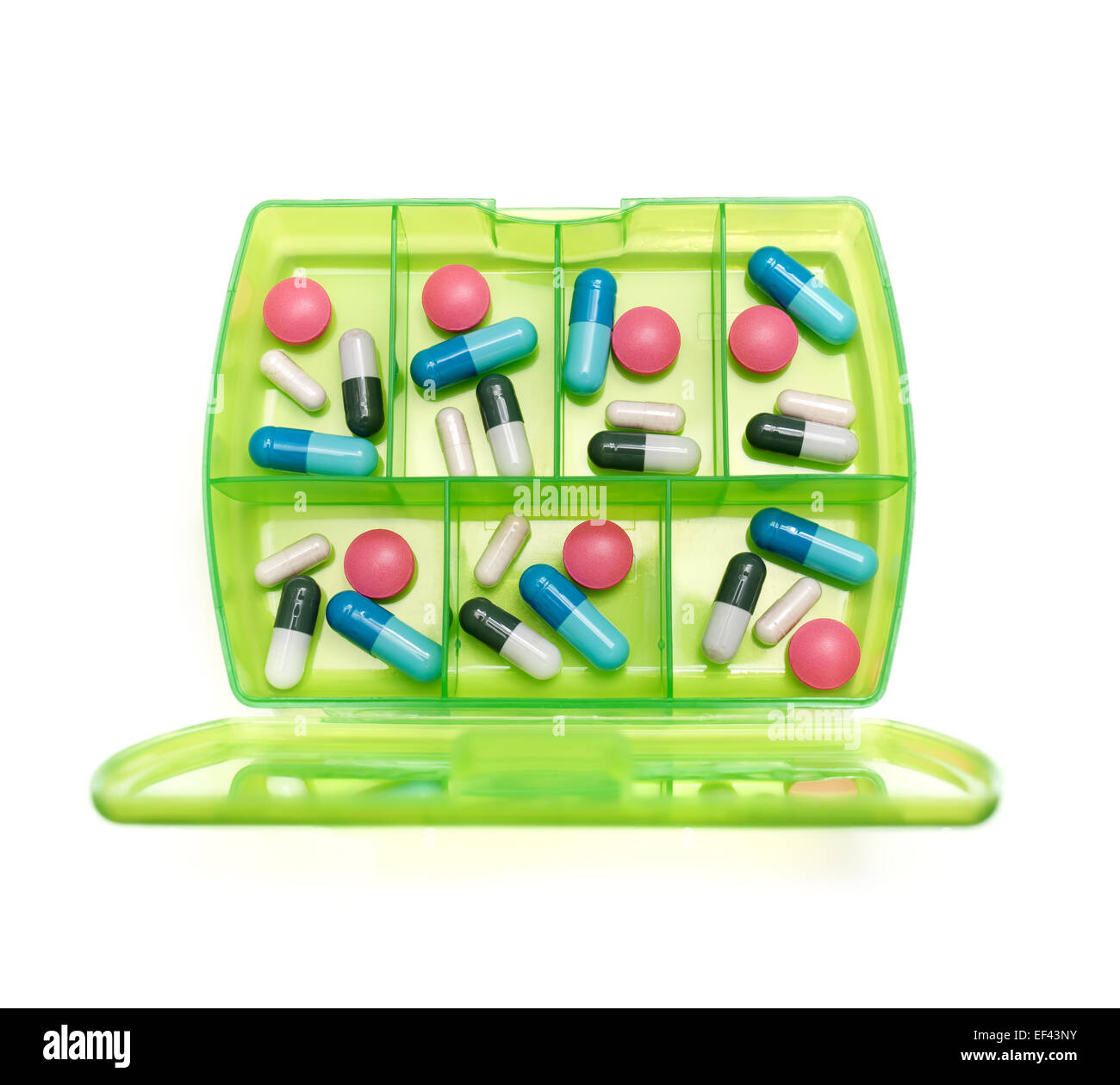 Box with a weekly dosage of various drugs on a white background. - Stock Image