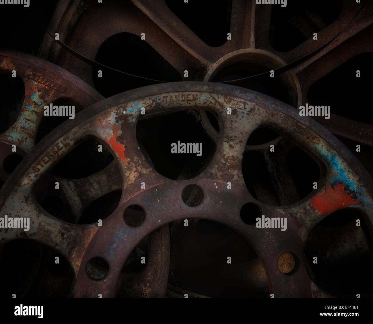 A dramatic high resolution fine art style image of fly wheels and gears near Jerome Arizona - Stock Image