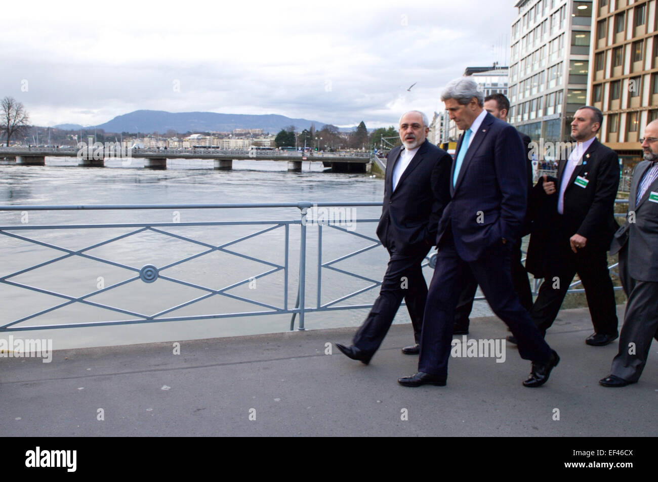 U.S. Secretary of State John Kerry and Iranian Foreign Minister Javad Zarif cross the Rhone River on the Pont de - Stock Image