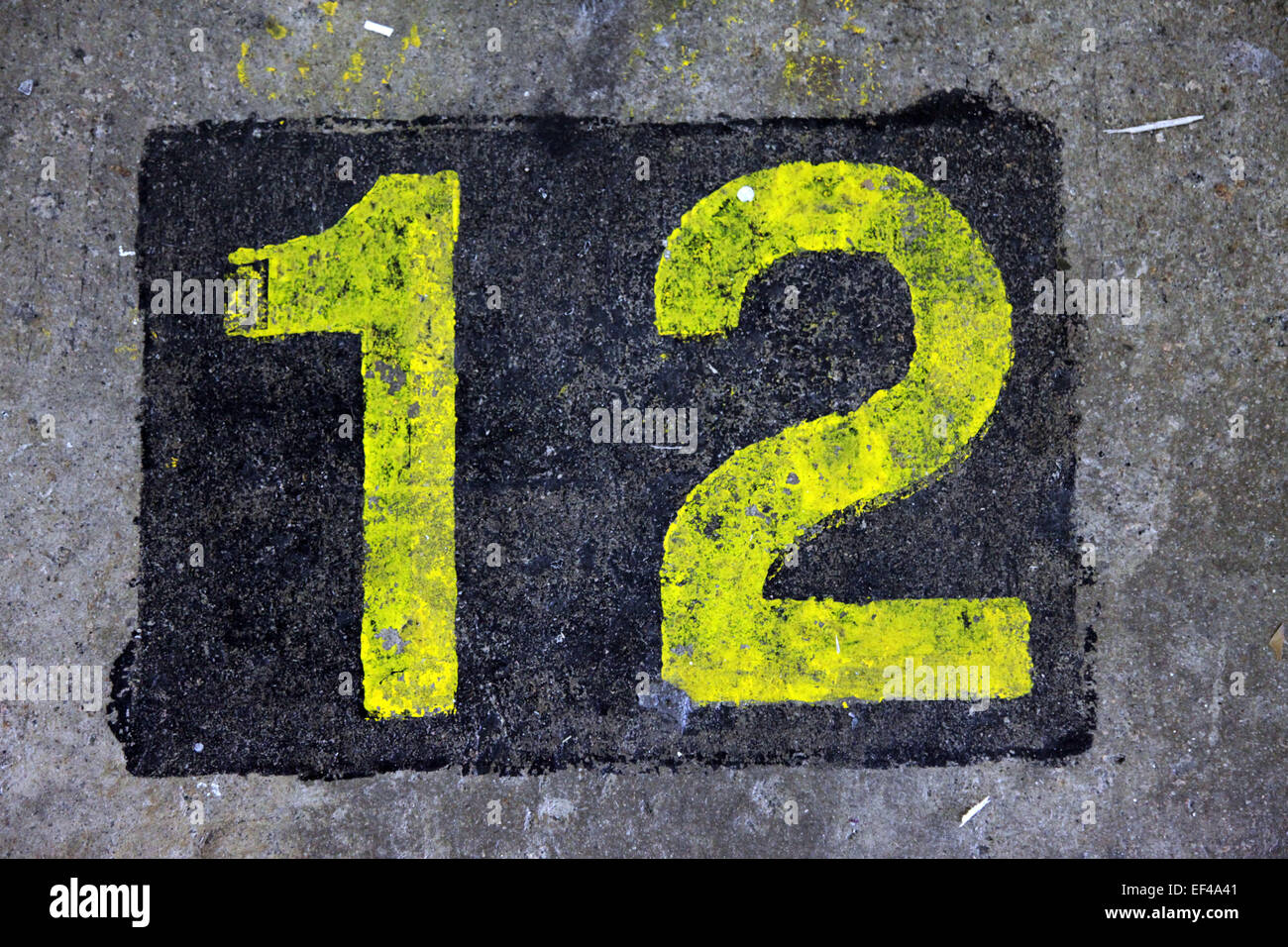 Top view of the number 12 painted in a stencil style in yellow color ...