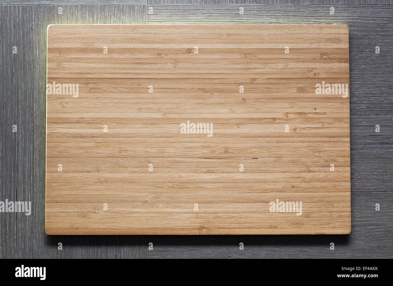 New wooden plate with empty textspace. - Stock Image