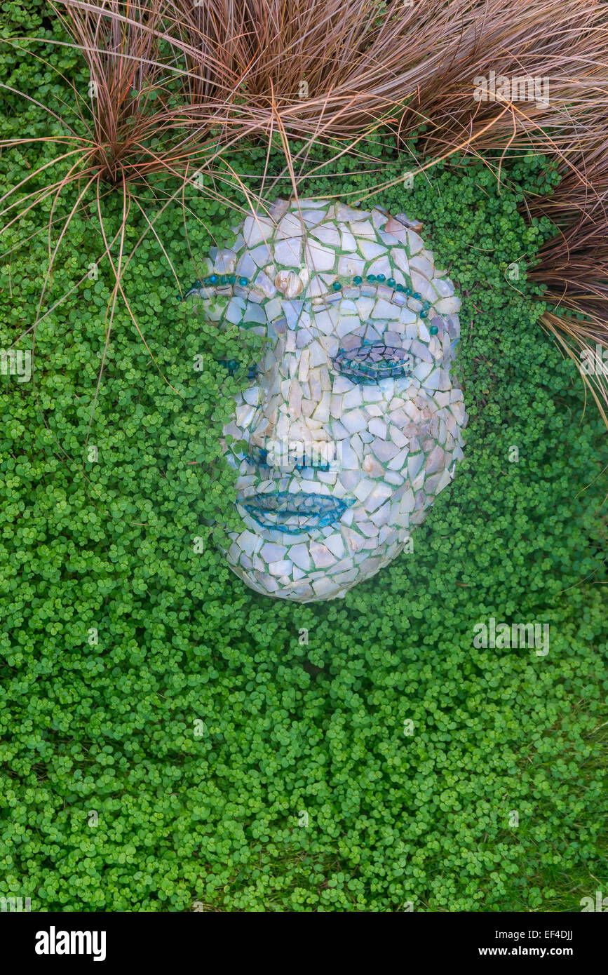 Gaia Earth goddess face in garden, the Muttart Conservatory, Edmonton, Alberta, Canada - Stock Image
