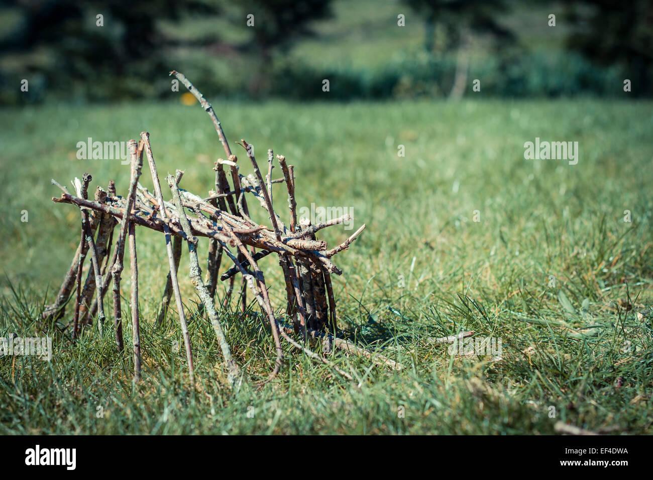 grass caban hut wood sticks little - Stock Image