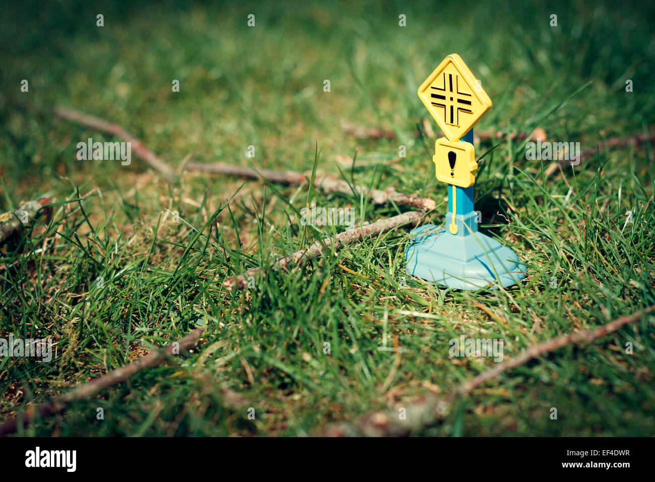 road sign toy grass macro photography - Stock Image