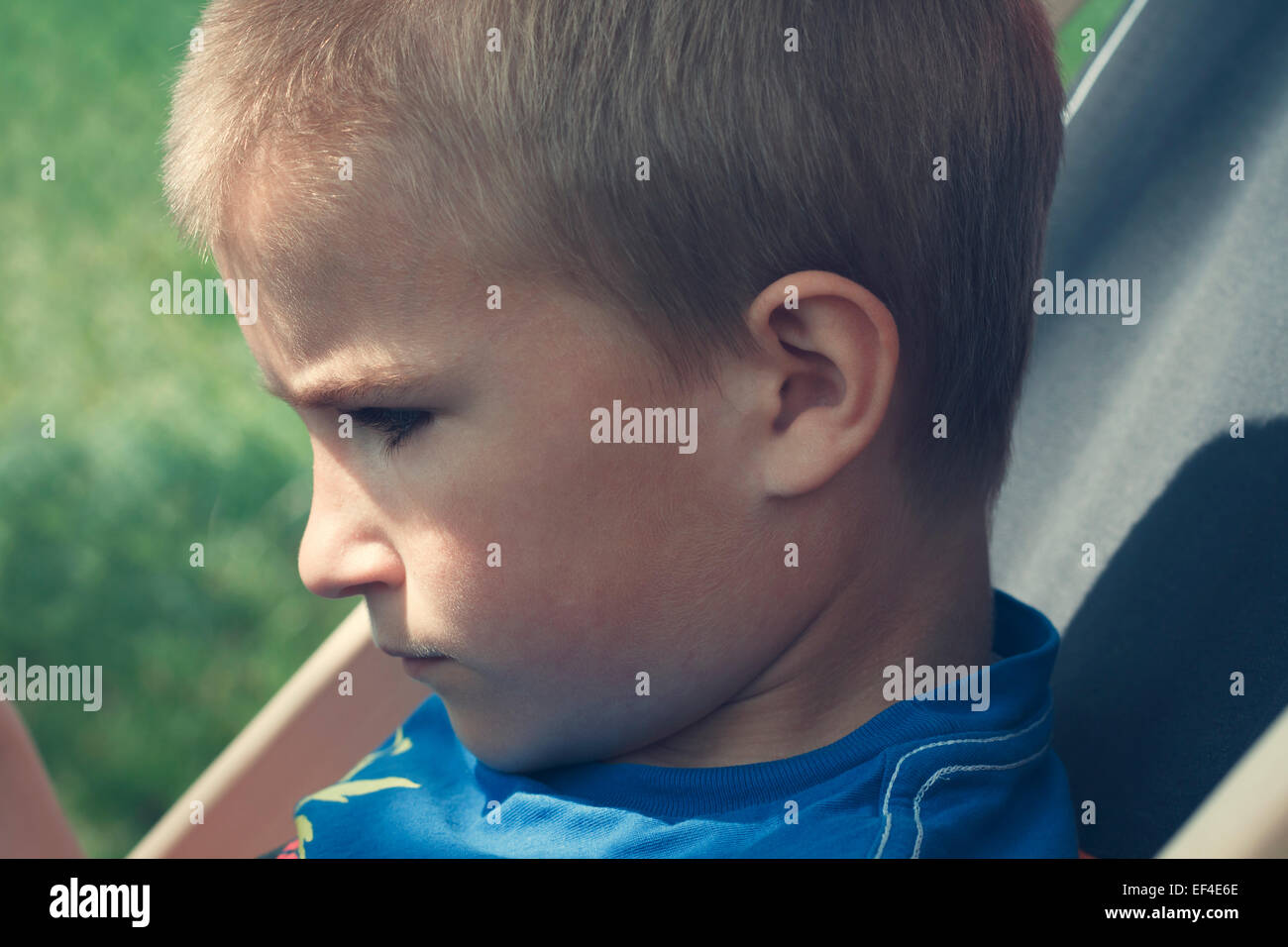 boy sitting summer chair, 8 years - Stock Image