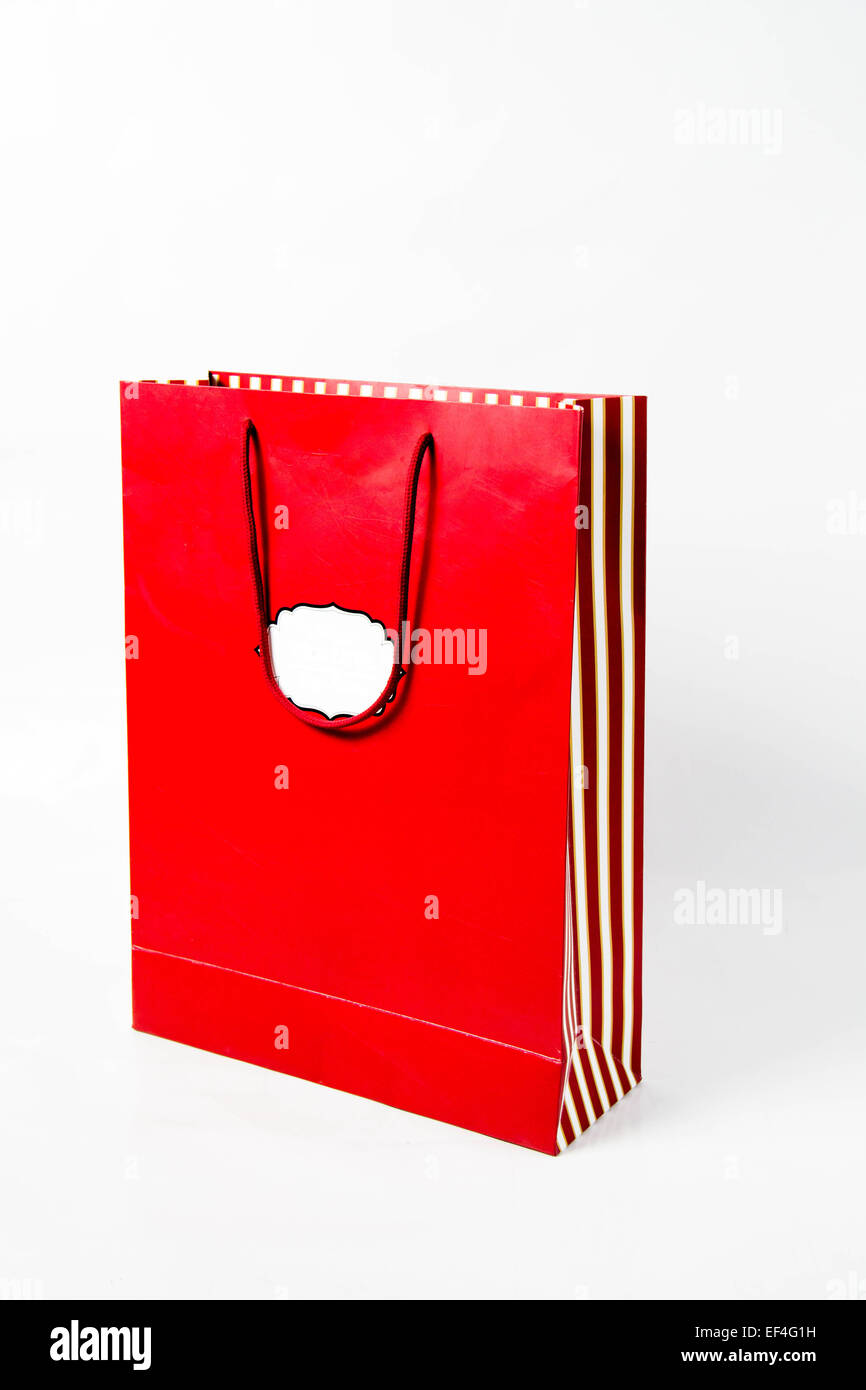 The Emptly red paper bag over white - Stock Image