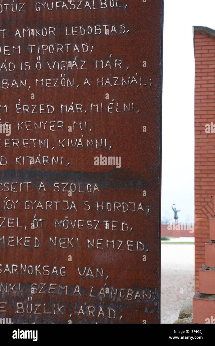 Poem about tyranny by Gyula Illyésby inscribed on rusted iron main gates, one of the statues can be glimpsed - Stock Image