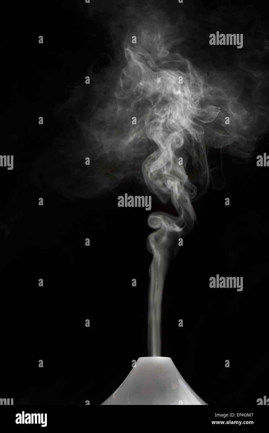 backlit on smoke - Stock Image